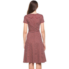 Sophisticated red a-line tea dress in a classic polka dot print.