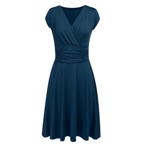 This universally flattering a-line dress features a classic surplice bodice, heavily ruched waist and demure knee length.