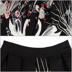Lovely 1950's-style black a-line skirt with swan print.