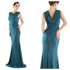 With its Grecian-inspired hourglass silhouette and rich, teal hue, this stunning floor-length gown captures the essence of classic Hollywood glamour and style.