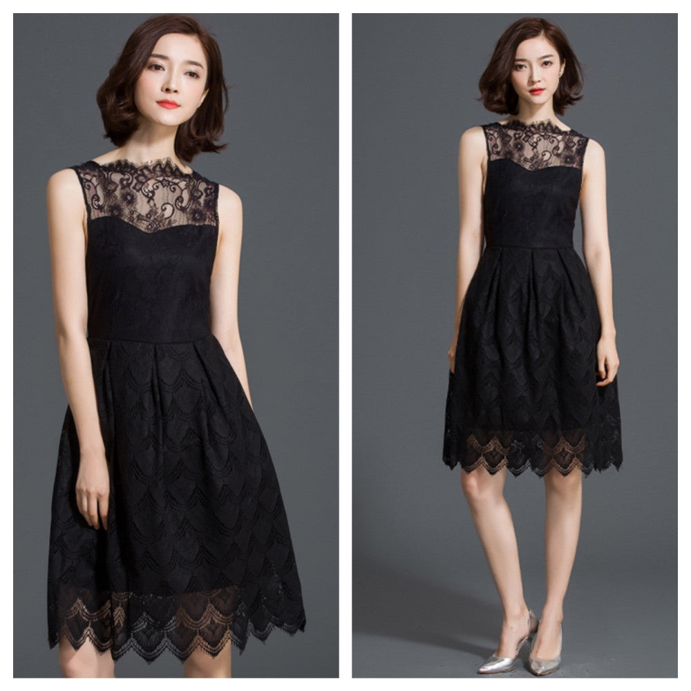 Exquisite black lace tulip dress with delicate eyelash detailing and scalloped hemline.