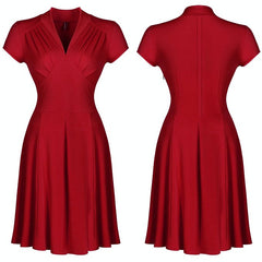 Sultry 1940s-inspired red a-line dress with a deep v neckline, ruched bodice and wide high waist. Lovely cap sleeves, softly pleated skirt.