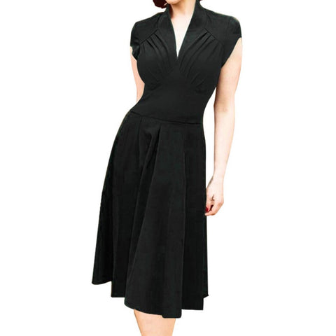 Sultry 1940s-inspired raven a-line dress with a deep v neckline, ruched bodice and wide high waist. Lovely cap sleeves, softly pleated skirt. Unlined.
