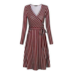 Classic faux wrap a-line dress in a flattering red vertical stripe print.