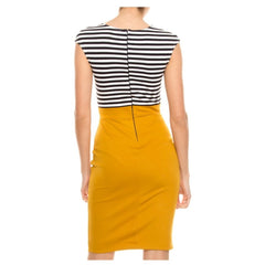 Black and white striped sheath dress with contrast mustard yellow skirt.