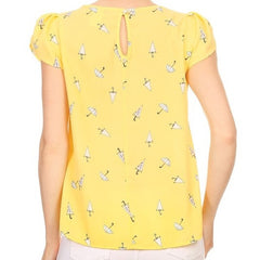 Charming yellow summer top with a pretty umbrella print.