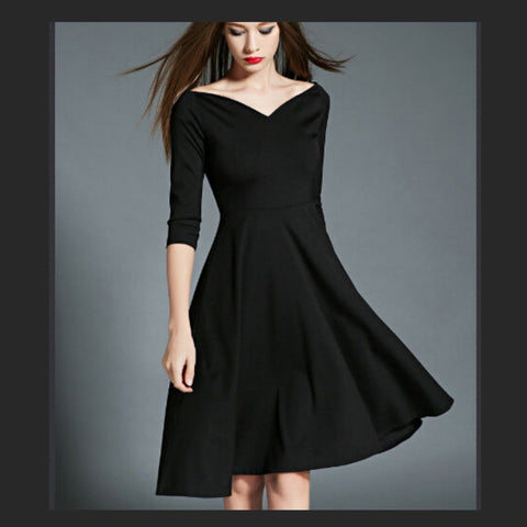 Black fit-and-flare dress with half sleeves and a sweetheart neckline.