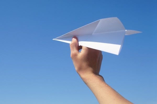 Paper Airplane Set Against A Blue Sky