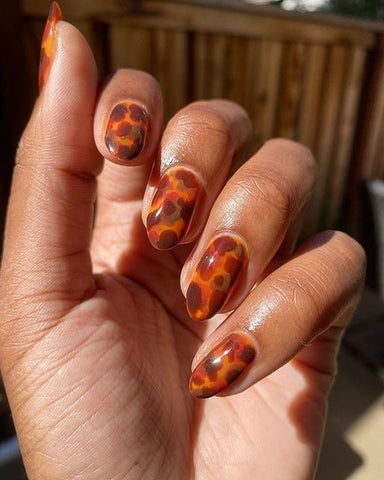Tortoise Shell Nail Art by @lolo.nailedit using Cirque Colors