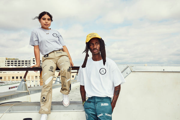 Image of models wearing gray and white Fuck Your Feelings tees