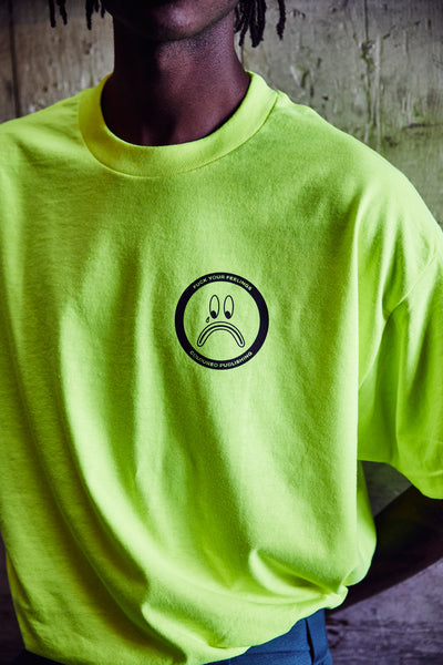 Image of model wearing neon Fuck Your Feelings tee