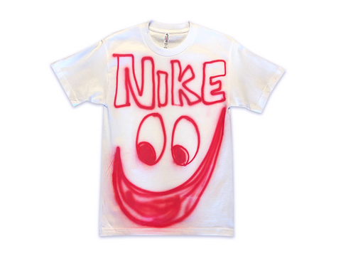 "Photo of an airbrushed t-shirt with ""Nike"" above a smiley face by artist Devin Troy Strother."