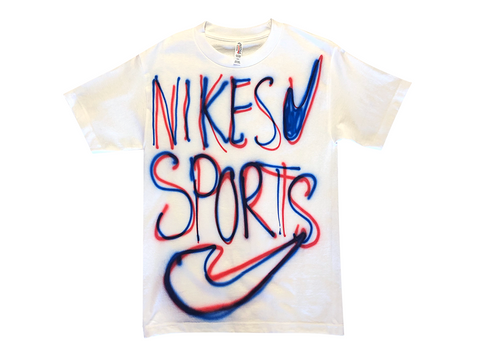 "Photo of an airbrushed t-shirt with the words ""Nikes Sports"" and two swoosh logos by artist Devin Troy Strother."