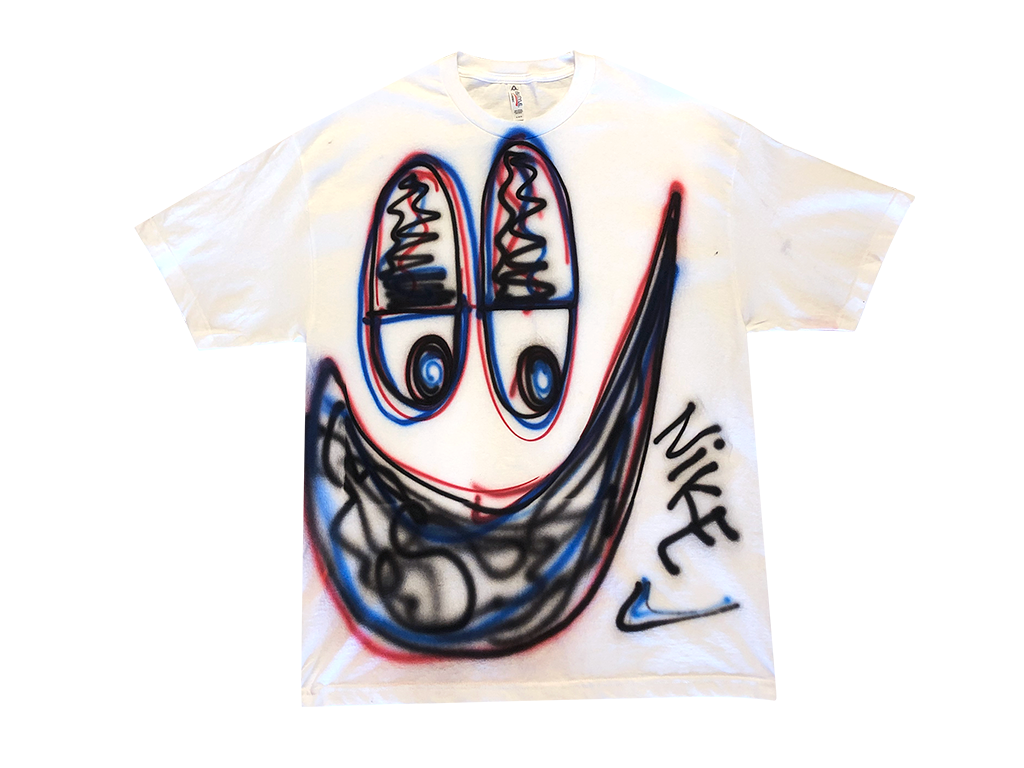 Photo of an airbrushed t-shirt with a smiley face by artist Devin Troy Strother.