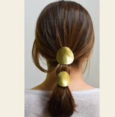 oval brass ponytail holder