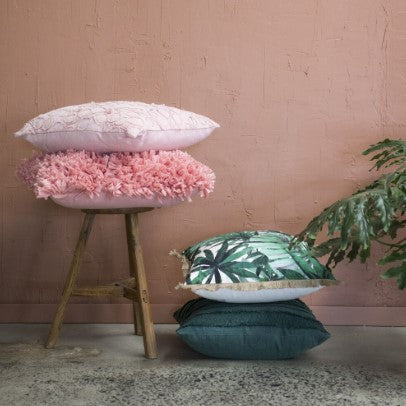 Tropical escape style guide pillows and stool lifestyle shot