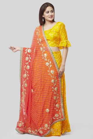 Sunshine Yellow Bandhej Ruffle Lehenga Choli with Peachy Orange Leheriya Dupatta