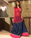 The Girlish Blue Brocade Blouse with Lehenga and Net Dupatta