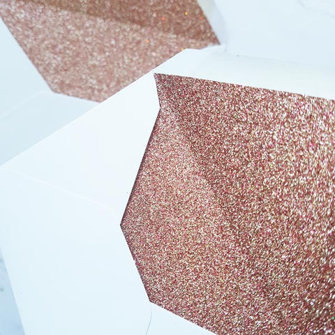 Rose gold glitter lined envelope