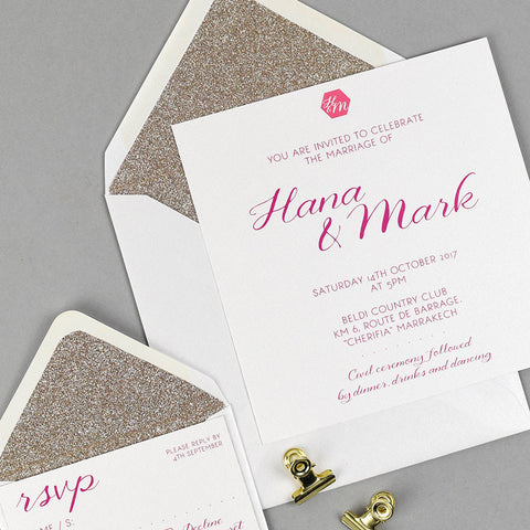 Geo Jasmine wedding invitation with gold glitter lined white envelope