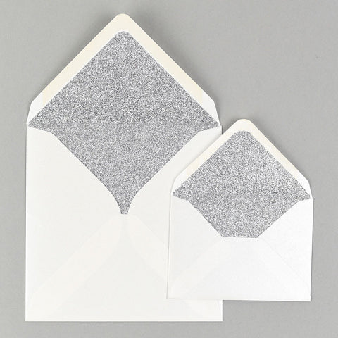 Silver glitter lined white envelope