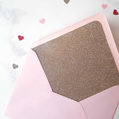 Champagne gold glitter-lined pink envelope