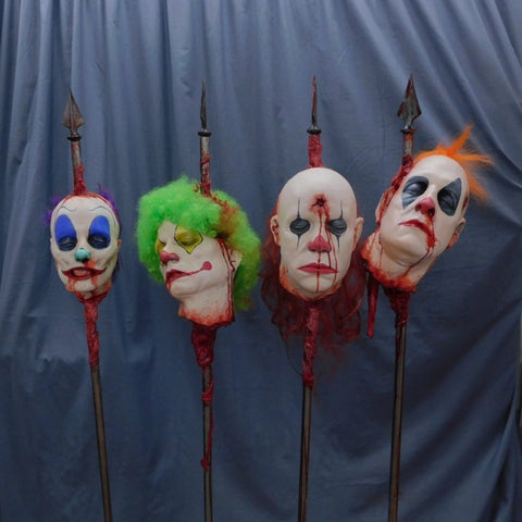 Clown Heads on Spikes 4 Pc Pack