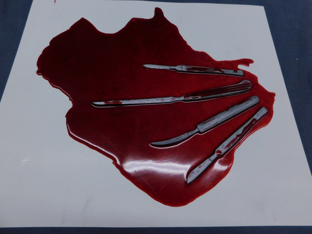 Blood Pool with Replica Scalpels