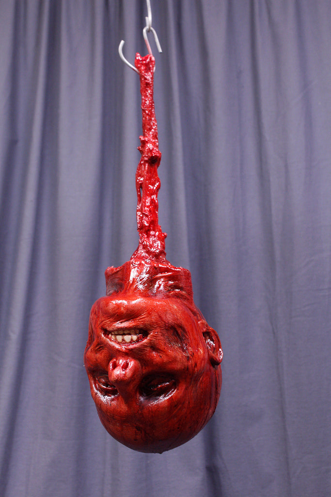 Hanging Skinned Luttra Head
