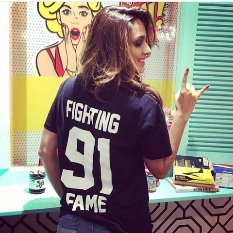 Kiara Alia Advani looking super glam on set in her Fighting Fame Classic 91 Home Jersey!