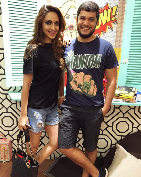 Kiara Alia Advani looking super glam on set in her Fighting Fame Classic 91 Home Jersey with photographer Taras Taraporvala!