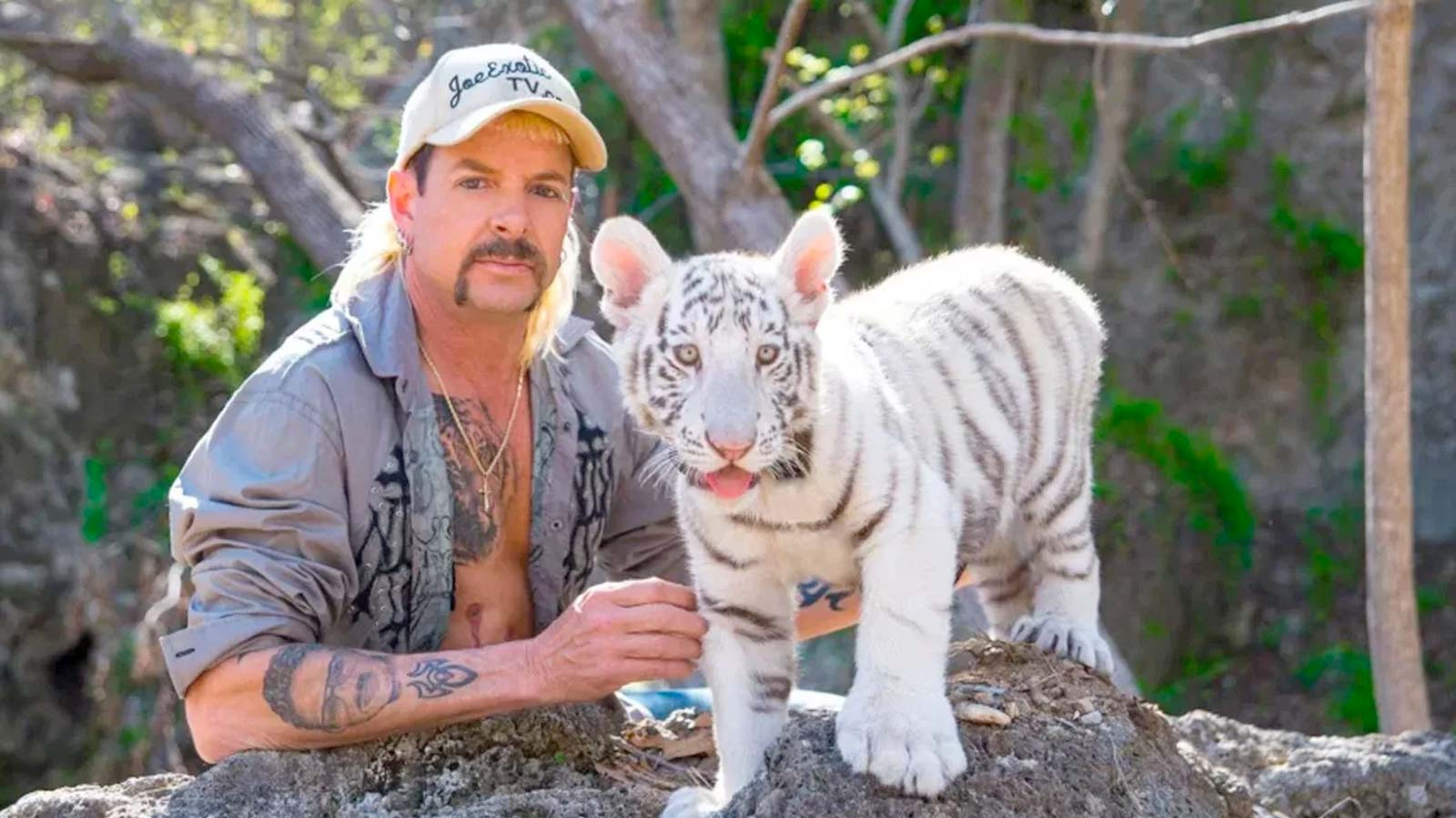 Joe Exotic with a white tiger cub