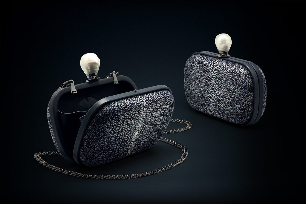 Dahlia stingray box clutch dark blue color with pearl clasp closure