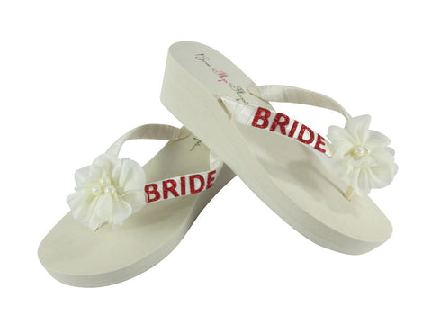Ivory 2 inch wedge flip flops with red glitter bride & chiffon pearl  flower accents