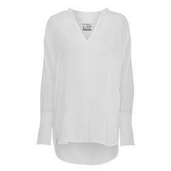 DITTE white shirt with ruffles and v-neck