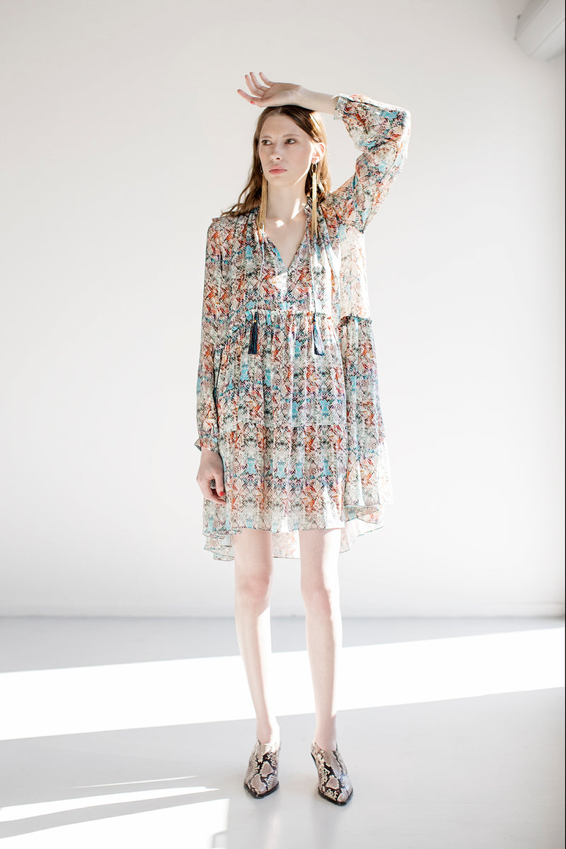 Short whisper dress with strings and tassels in multi color print