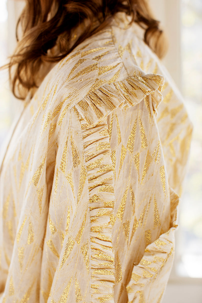 Linea shirt with gold details, drawstring and ruffled sleeves
