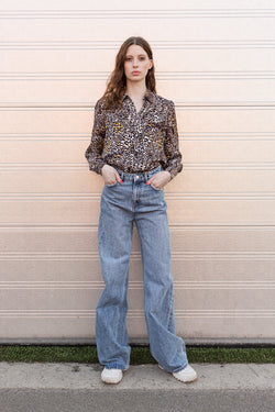 Wester shirt in leopard print with collar and buttons styled with jeans
