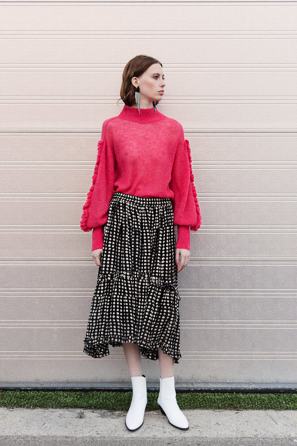 Lone hand knit shirt in pink with ruffles on sleeves styled with Lucy black white printed skirt