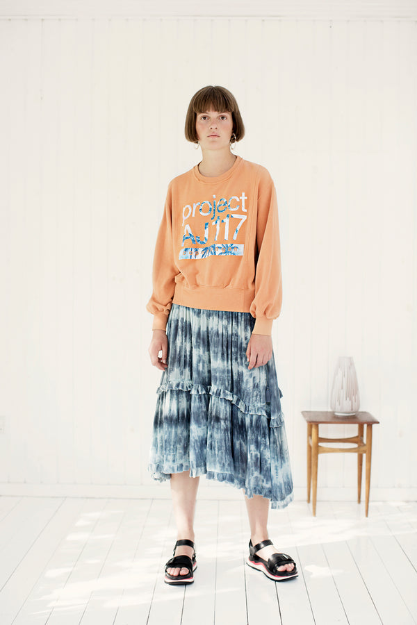 tie dye skirt in blue with orange sweat shirt with logo print