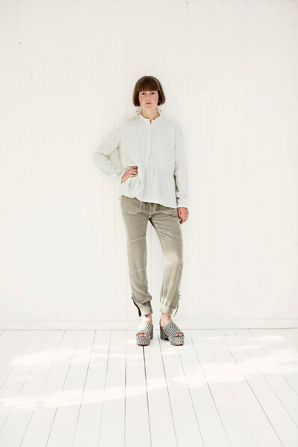 offwhite stripe shirt styled with denver pants