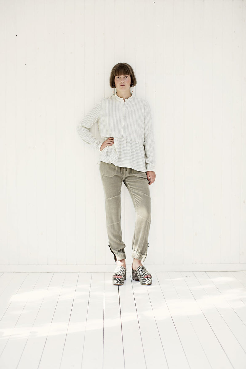project aj117 moss long pants with white shirt