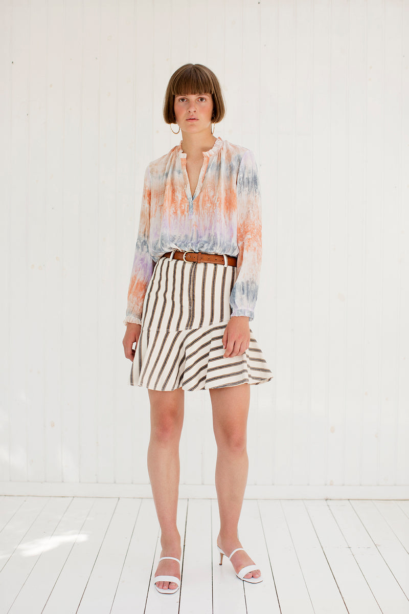 tie dye shirt in pastel colors with striped skirt