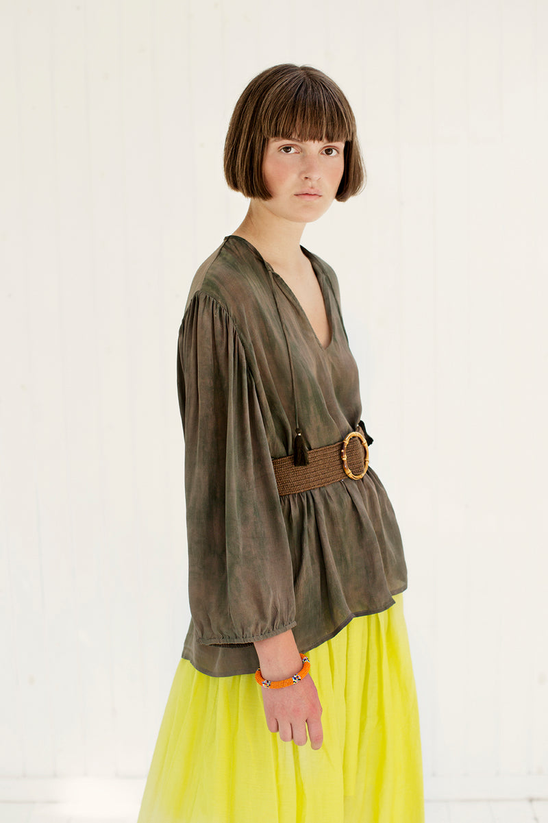 tie dye shirt in army with v-neck and yellow marli skirt