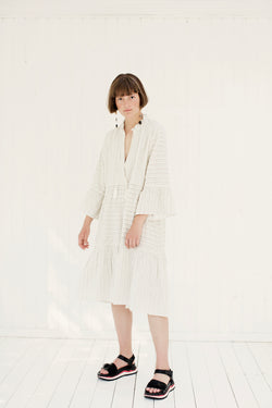 offwhite long loose dress with tassels and layered skirt