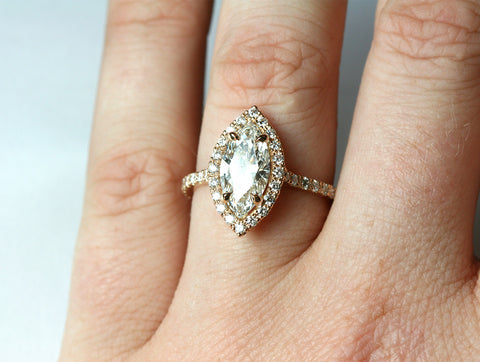Marquise Diamond and Rose Gold Engagement Ring on hand
