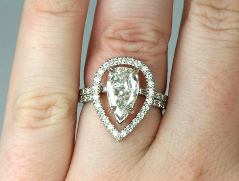 Pear Shaped Diamond Stacking Rings on finger