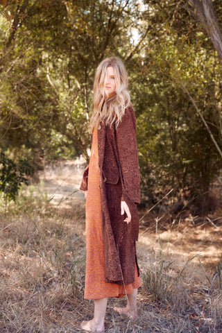 Model wearing the Carla Corduroy Coat over the Stevie Corduroy Jumpsuit in the park