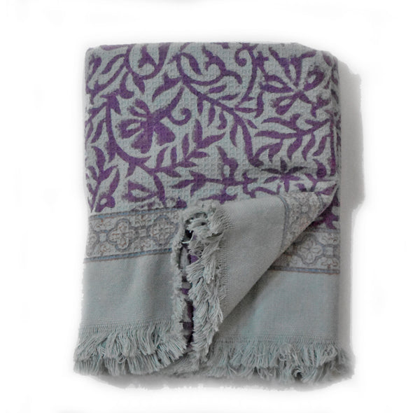 Floral block printed waffle weave cotton towel with fringe ends.