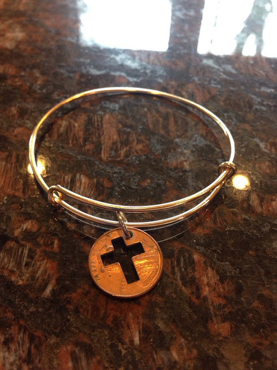 Cross cut from a penny expandable wire bangle bracelet
